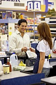 Man paying by credit card at supermarket check-out