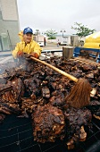 Man barbecuing at Owensboro International BBQ Festival (USA)