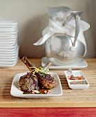 Fried lamb chops with flaked almonds, spices, water jug