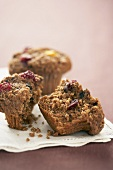 Two cranberry bran muffins, one halved