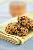Oat and cranberry cookies on napkin
