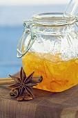 Jar of orange marmalade, star anise and cinnamon sticks