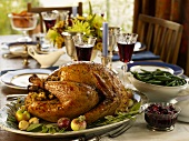 Roast turkey and accompaniments on laid table (USA)