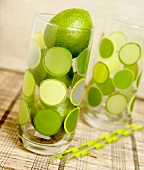 Three limes in glass with green spots