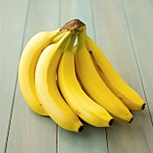 A bunch of bananas on blue painted wood