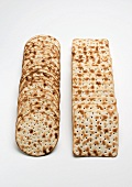 Two rows of matzoh crackers (round and square)