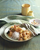 Shrimps with pineapple in red curry sauce, glass noodles