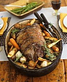 Rolled lamb roast with root vegetables and rosemary