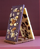 Three bars of chocolate with nuts and ginger