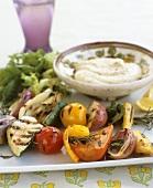 Grilled vegetables on rosemary skewers with hummus