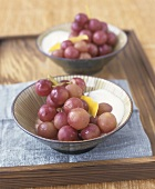Red grapes with yoghurt and lemon peel
