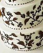 Tiered white cake with chocolate leaves (detail)