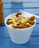 Poutine (Chips with curd cheese and gravy, Canada)