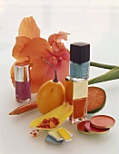 Still life with make-up, fruit and amaryllis flower