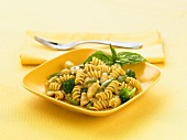 Bowl of Rotini Pasta with Broccoli and Basil Sprig, Fork