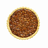 Overhead of a Whole Pecan Pie on a White Background