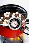 Candy Thermometer on a Pot of Melting Mini Marshmallows and Chocolate Chips