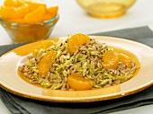 Caraway Cabbage and Rice with Orange Wedges on a Plate