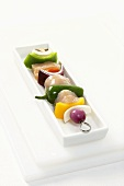 Uncooked Chicken and Vegetable Kabob on a White Rectangular Dish