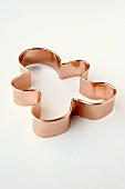 Copper Gingerbread Man Cookie Cutter on White Background