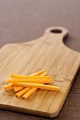 Carrot Sticks on a Cutting Board