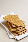 Graham Crackers Stacked on a White Cloth Napkin