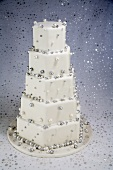 Five Tiered White and Silver Cake