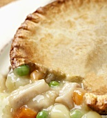 Close Up of Chicken Pot Pie with Part of Crust Removed to Show Filling
