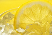 Close Up of the Top of a Glass of Lemonade on Ice with a Lemon Slice
