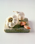Garlic Bulbs and Cloves on Tile