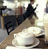 A Cup of Cappucino with a Bagel and Cream Cheese