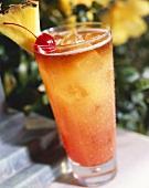 Tropical Drink (Mai Tai) with Pineapple and Cherry Garnish