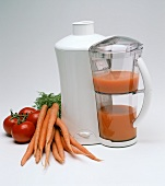 Krups Juice Machine with Carrots and Tomatoes