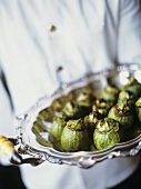 Chef Holding a Tray Stuffed Tomatillos