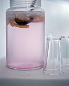 A Jug of Pink Lemonade with Glasses