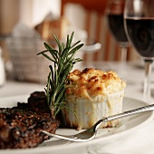 Individual Macaroni and Cheese with a Steak