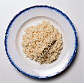 Risotto with a Thyme Sprig on a Plate; From Above