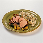 Sliced Pork Loin Over Vegetables with Rice