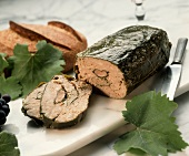 Grape leaf wrapped terrine