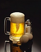 A Mug of Beer with Hard Boiled Eggs and a Salt Shaker