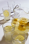 Lemonade in a Pitcher and Several Glasses