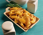 French Fries with Cheddar Cheese Sauce in a Dish