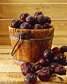 Purple Plums in and Around a Wooden Bucket