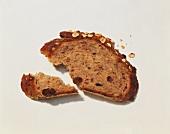 A Slice of Whole Grain Bread with a Piece Broken off