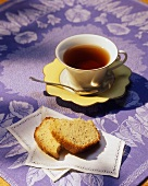 Slices of Poppyseed Bread on a Cloth Napkin with a Cup of Tea