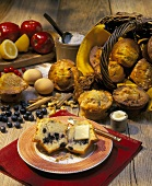 Blueberry muffin with butter; ingredients; basket of muffins