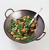 Shrimp and Pea Pods Stir Fried in a Wok