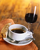 Cup of Espresso with Biscotti and a Glass of Red Wine