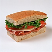 Ham and Cheese Sandwich on Focaccia Bread; White Background