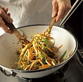 Warm Asian Vegetable Salad Being Tossed
